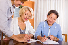 Women consulting at insurance agent Stock Photos