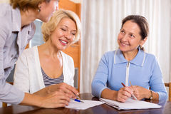 Women consulting at insurance agent Stock Image