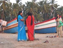 Women conversing on beach Stock Images