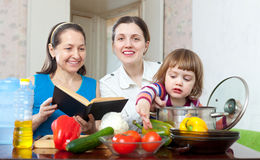 Women cook vegetables in the kitchen Royalty Free Stock Photos