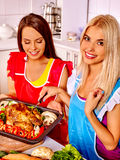 Women cooking chicken at kitchen Royalty Free Stock Images