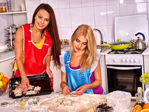 Women cooking dough on home kitchen. Royalty Free Stock Image