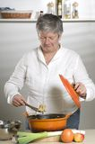 Women is cooking food royalty free stock photography