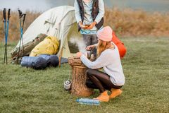 Women cooking food at the camping Royalty Free Stock Photos