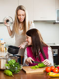 Women cooking food Royalty Free Stock Photography
