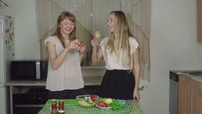 Women Cooking Food on a Kitchen and Talking drinking champagne smiling rapid 50fps healthy food. Women Cooking Food on a Kitchen and Talking cut salad healthy stock video