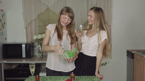 Women Cooking Food on a Kitchen and Talking healthy food. Interferes and tries salad stock footage