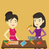 Women cooking healthy vegetable meal. Royalty Free Stock Photo