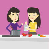 Women cooking healthy vegetable meal. Royalty Free Stock Photography