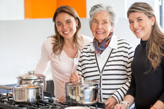 Women cooking at home Royalty Free Stock Photo
