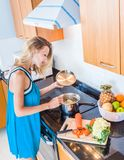 Women cooking in the kitchen at home Royalty Free Stock Photography