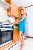 Women cooking in the kitchen at home Stock Photos