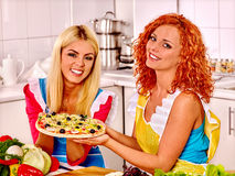 Women cooking pizza Royalty Free Stock Images