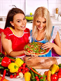 Women cooking pizza Royalty Free Stock Photos