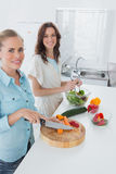 Women cooking together and looking at camera Stock Photo