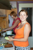 Women cooks  in  kitchen Royalty Free Stock Images