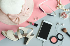 Women cosmetics and fashion items with copy space. Women cosmetics and fashion items on color background with copy space, Top view Stock Image