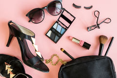 Women cosmetics and fashion items. On pink background, Top view Royalty Free Stock Photo