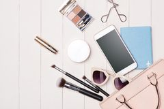 Women cosmetics and fashion items on table with camera and passp. Ort. Top view Royalty Free Stock Photos