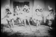 Women in costume practing dance routine in living room stock footage