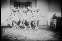 Women in costume rehearsing dance routine in living room stock video footage