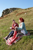 Women on country picnic. Smiling having fun Stock Photos