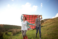 Women in countryside running Royalty Free Stock Image
