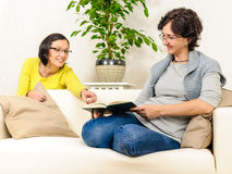 Women couple family reading book relaxing time Stock Photos