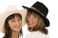 Women in cowboy hats Stock Images