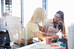Women coworkers talking in an office Royalty Free Stock Photo