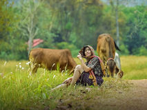 Women and cows. In green pastures n Stock Images