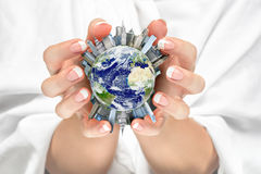 Women cradling the Earth city. In her hands Royalty Free Stock Images