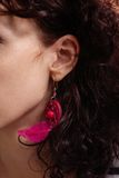 Women with creative indian-style earring in her ear Royalty Free Stock Photography