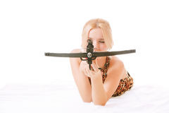 Women with crossbow. Girl in dress of leopard colour with arbalest Stock Photo