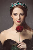 Women with crown. Portrait of a young woman with crown. Photo in old color image style Royalty Free Stock Photos