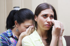 Women cry. A women crying and give solace her friend Stock Photos