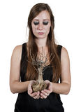 Women crying over dead tree stock photos