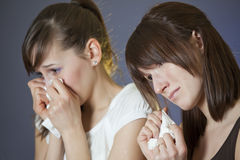Women crying by watching TV Royalty Free Stock Photo