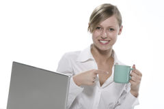 Women with cup of coffee and computers Stock Image