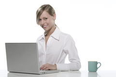 Women with cup of coffee and computers Royalty Free Stock Photography