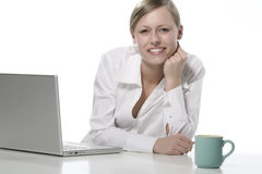 Women with cup of coffee and computers Stock Images