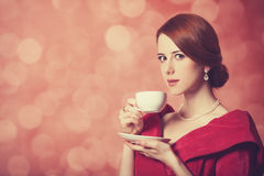 Women with cup of tea. Royalty Free Stock Photos