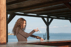 Women customer paying in euros at the beach bar Royalty Free Stock Photos