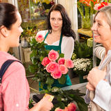 Women customers buying card flower shop pink Stock Photo
