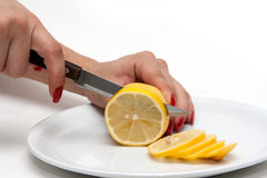 Women cut lemon Royalty Free Stock Photos