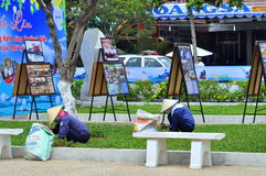 Women are cutting grass in a park in Nha Trang city Stock Photo