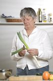 Women is cutting leek Stock Photo