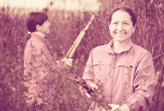 Women cutting shrubbery. Two women cutting shrubbery at garden Royalty Free Stock Photography