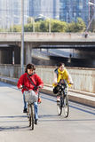 Women cycle in Beijing suburb on a sunny day, China Stock Photos