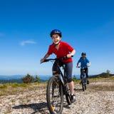 Women cycling. In mountain scenery Stock Photos